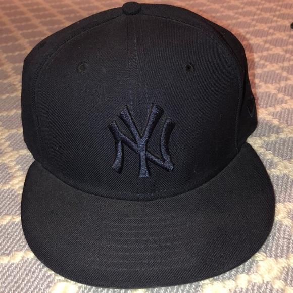 b0edba5066a  New Era  all black Yankees cap. M 5b7cade0f41452622421ffc7